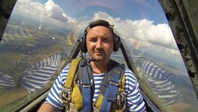 Shocked man in aerobatic aircraft in the sky stock video