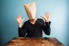 Shocked man with bag over head Stock Photo