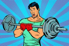 Shocked man with a barbell in the gym Stock Image
