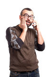 Shocked man with beard talking by cell phone Royalty Free Stock Images