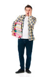 Shocked man with books. Full lenght portrait of shocked teenager with books. Male student expressing shocking emotions. Young man holding textbooks isolated on Stock Photography