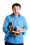 Shocked man with books in hand Stock Image