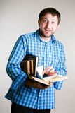 Shocked man with books in hand Stock Photo