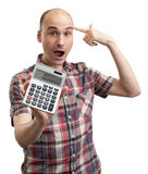 Shocked man with calculator Royalty Free Stock Photos