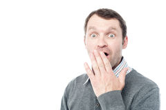 Shocked man covering his mouth with hand Royalty Free Stock Images