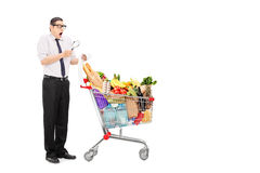 Shocked man examining the shopping bill Stock Photos