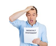 Shocked man, financial problems Stock Images