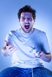 Shocked Man with Gamepad Royalty Free Stock Image