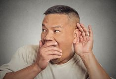 Shocked man hand to ear listening Royalty Free Stock Images