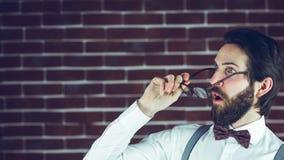 Shocked man holding eyeglases Royalty Free Stock Image