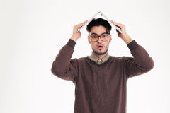 Shocked man holding laptop computer over head Royalty Free Stock Images
