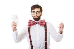 Shocked man holding menstruation pad. Stock Images