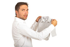 Shocked man holding shrunk shirt Stock Photos
