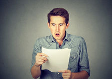 Shocked man holding some documents royalty free stock images