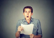 Shocked man holding some documents stock photos