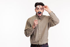 Shocked man holding stick with mustache Stock Photo