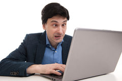 Shocked man with laptop Royalty Free Stock Photography