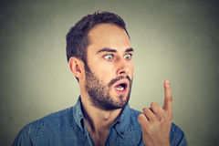 Shocked man looking at his finger Stock Photo
