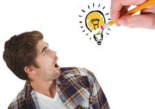 Shocked man looking at innovative bulb drawn on white background Stock Photo