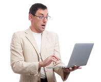 Shocked man looking at laptop Stock Photo