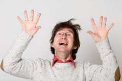 Shocked man looking up with his mouth open Royalty Free Stock Image