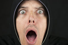Shocked Man Looks To Camera Stock Photo