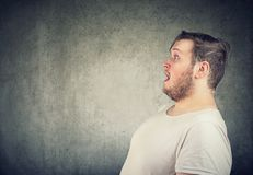Shocked man with mouth opened stock image