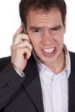 Shocked man on phone Royalty Free Stock Images