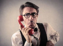 Shocked man at the phone Stock Photography