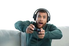 Man playing video game against white background royalty free stock photography