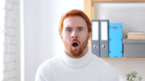 Shocked Man with Red Hairs at Work, Amazed by Surprise Stock Image