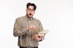 Shocked man standing with book Stock Photos