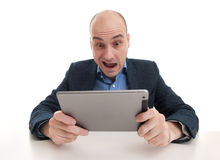 Shocked man with tablet computer stock photo