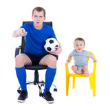 Shocked man in uniform and little boy watching soccer game isola Stock Image