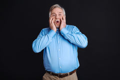 Shocked man with wide opened eyes and mouth Stock Photos