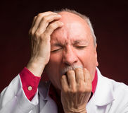 Shocked mature doctor Royalty Free Stock Images