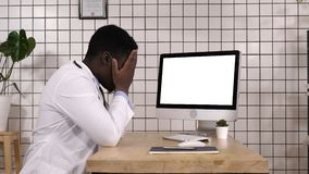 Shocked medical doctor looking on the screen of computer. White Display. View to the screen of computer.Shocked medical doctor looking on the screen of computer stock video footage