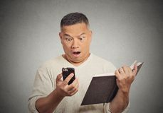 Shocked middle aged man looking at phone Stock Image