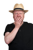 Shocked middle aged man in straw hat Royalty Free Stock Image