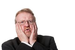Shocked middle aged man in tuxedo on white Royalty Free Stock Photos