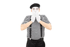 Shocked mime artist standing in disbelief Royalty Free Stock Images