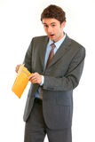 Shocked modern businessman checking parcel Stock Photos