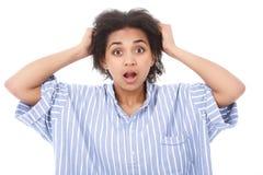 Shocked mulatto girl against isolated background Royalty Free Stock Image