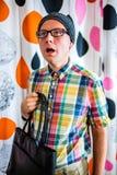 Shocked nerd standing with black bag Stock Photos