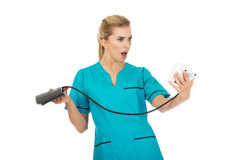 Shocked nurse or doctor with pressure gauge Stock Images