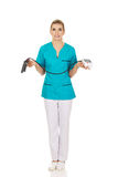 Shocked nurse or doctor with pressure gauge Royalty Free Stock Images