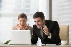 Shocked office people looking at laptop screen, unbelievable ama Stock Images