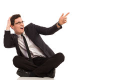Shocked office worker pointing at the air. Stock Photo