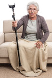 Shocked old woman with crutch Royalty Free Stock Image