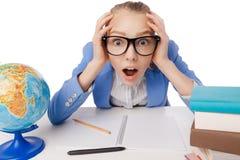 Shocked overwhelmed student wearing glasses Stock Image